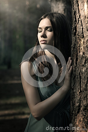 Beautiful woman in nature scenery