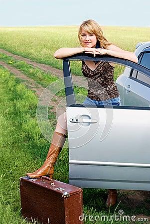 Beautiful woman near her car