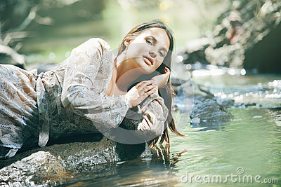 Beautiful woman near water