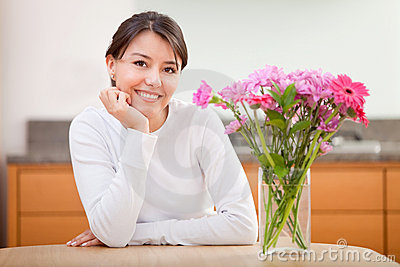 Beautiful woman next to flowers