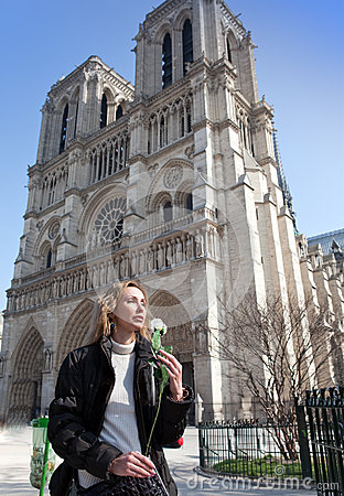 Beautiful woman  before Notre Dame de Paris