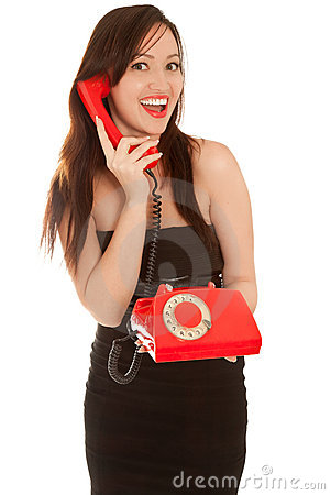 Beautiful woman with old red telephone talking