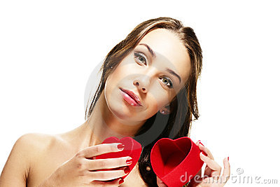Beautiful woman opening heart shaped present box