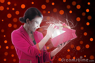 Beautiful Woman Opens a present