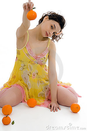 Beautiful woman with oranges