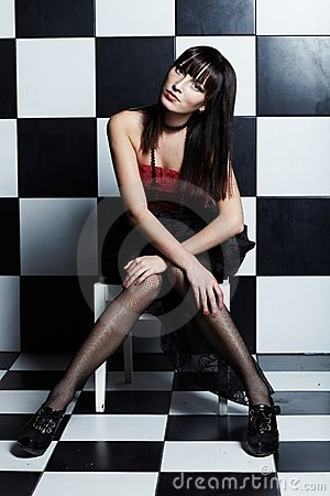 Free Beautiful Woman Over Chess Coloured Wall Royalty Free Stock Images - 16383839
