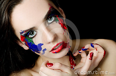 The beautiful woman with a paint on the face