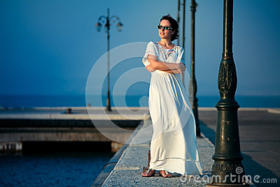 Beautiful woman on a pier