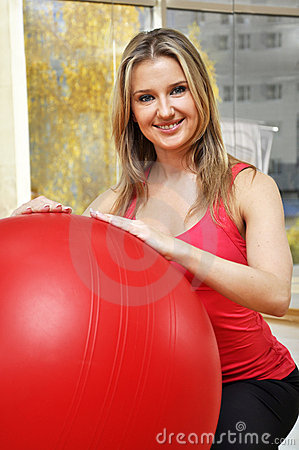 Beautiful woman with pilates ball