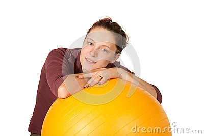 Beautiful woman with a pilates ball