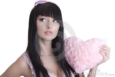 Beautiful woman in pink glasses with plush heart