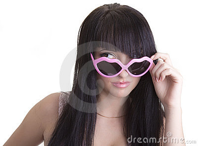 Beautiful woman in pink party glasses