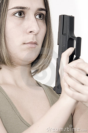 Beautiful woman with a pistol