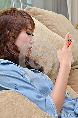 Beautiful woman playing with her mobild phone