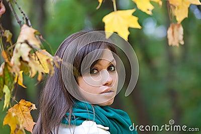 Beautiful woman portrait in autumn forest