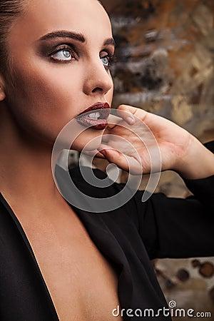 Beautiful woman pose in studio. Vogue style photo.