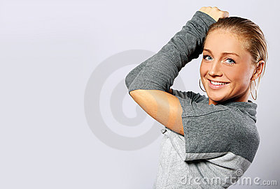 Beautiful woman posing over gray background