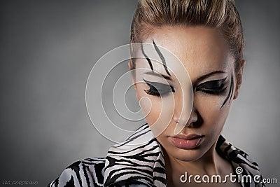 Beautiful woman posing in studio in zebra coat