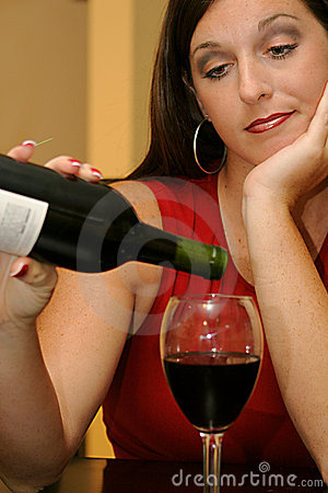 Beautiful woman pouring wine