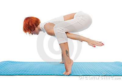 Beautiful woman practicing yoga asana