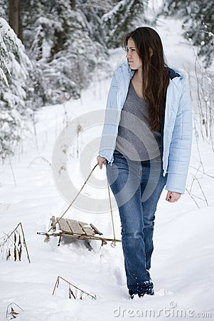 Beautiful woman pulling sled