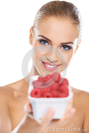 Beautiful woman with punnet of raspberries