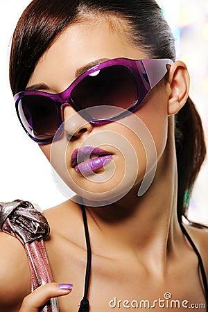 Beautiful woman with purple fashion sunglasses
