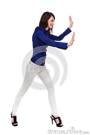 Beautiful woman pushing something