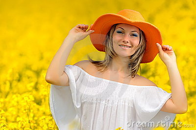 Beautiful woman on rape field