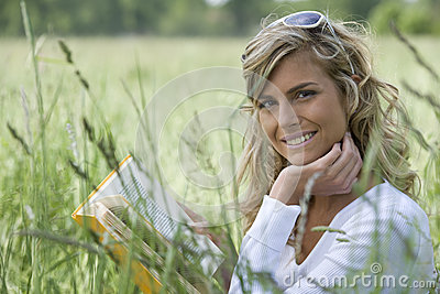 Beautiful Woman Reading Outdoors
