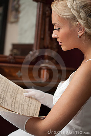 Beautiful woman reading vintage sheet music