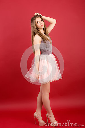Beautiful woman on red background