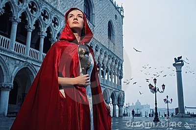 Beautiful woman in red cloak