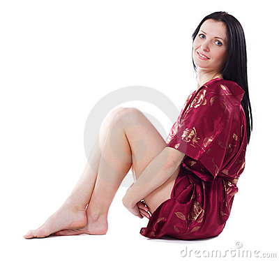 Beautiful woman in red dressing gown
