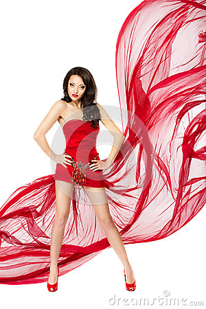 Beautiful woman in red flying dress. Hands on hips