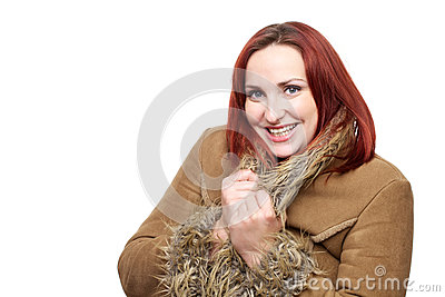 Beautiful woman with red hair in winter coat