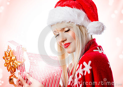 Beautiful woman in red hat with opened gift box