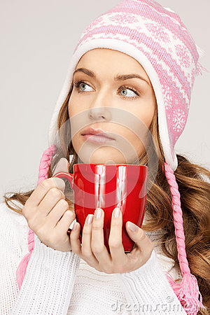 Beautiful woman with red mug