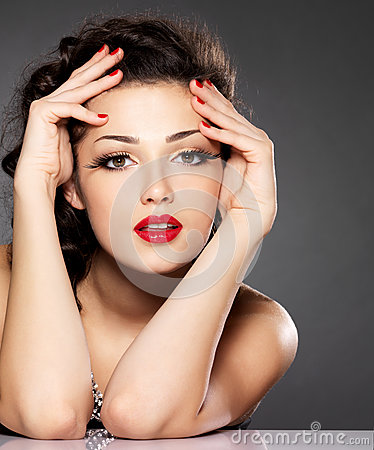 Beautiful woman with red nails