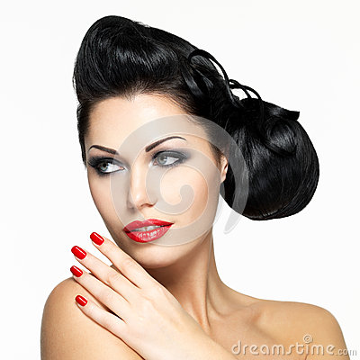 Beautiful woman with red nails and lips