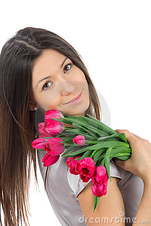 Beautiful woman with red tulips bouquet