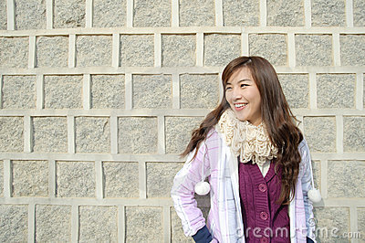 Beautiful woman relax action against wall