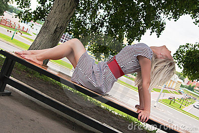 Beautiful woman relaxing on the bench