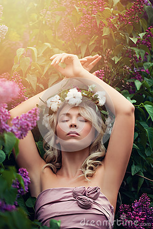 Free Beautiful Woman Relaxing In Flowers Outdoors Stock Photo - 93672740