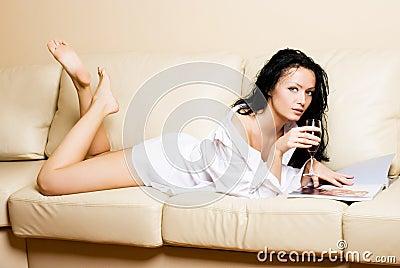 Beautiful woman relaxing on the sofa