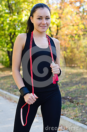 Beautiful woman with a resistance band