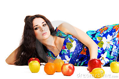 Beautiful woman resting with fresh fruits