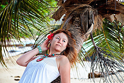 Beautiful woman resting on a palm