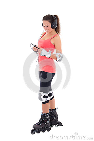 Beautiful woman in roller skates listening music on white backgr