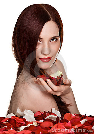 Beautiful woman and rose petals